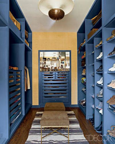NATE BERKUS'S BLUE CLOSET. For the dressing room of his Chicago apartment, interior designer Nate Berkus opts for a sporty blue closet. The space has vintage touches, including a wardrobe and mirror installed during the apartment's 1940s renovation by architect Samuel Marx, as well as a midcentury French light fixture. The 1960s Paul McCobb stools are upholstered in men's suiting corduroy.