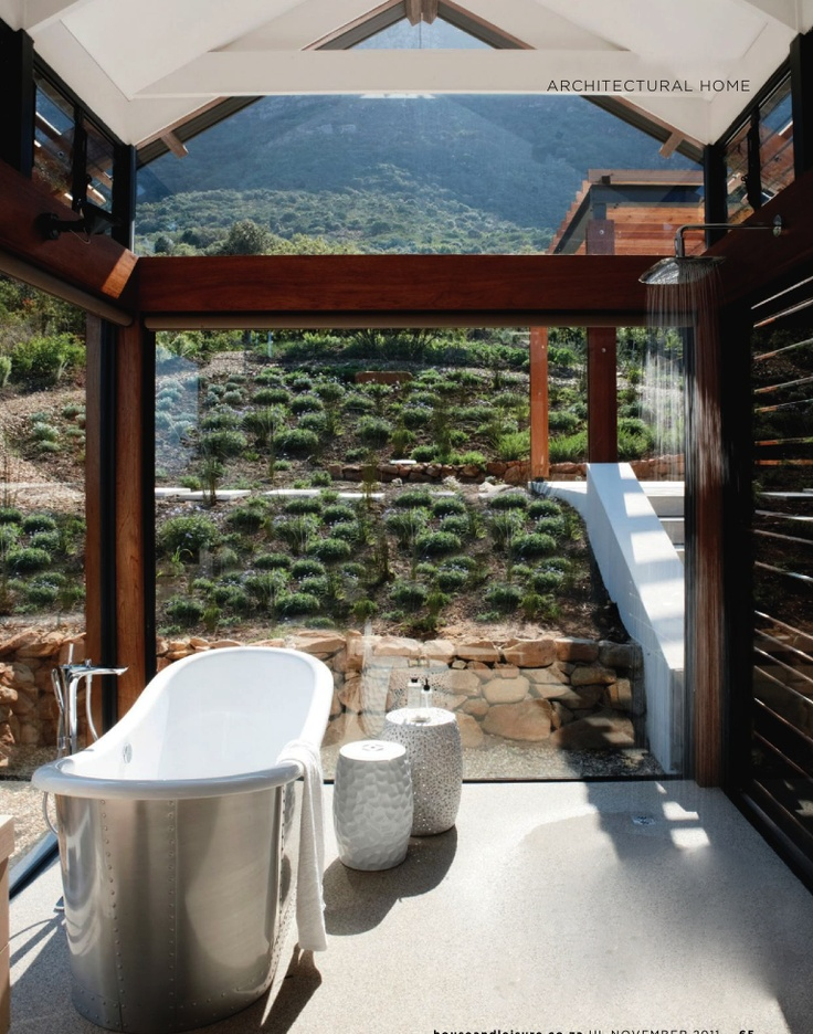 Beautiful Tub in an all glass wall & ceiling bathroom with an amazing view!