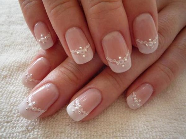 Wedding themed nails with elegant lace and diamond ornaments.