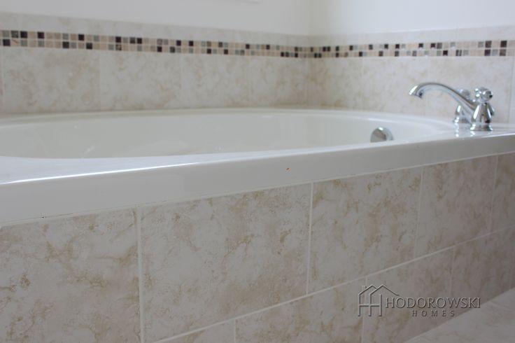 This garden tub chose brick laid city collection cream for Master bathroom garden tub