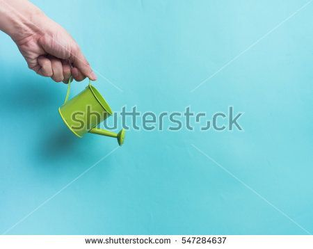 Watering can color and color background for copy space create idea for business ,something.