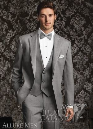 "<p style=""text-align: left;""><span style=""font-size: medium;"">The Sharkskin Grey 'Grayson' Tuxedo by Ike Behar Evening is a beautifully made formal ensemble that fills a specific and growing need in our rental tuxedo offerings. We have grey tuxedos. We have slim fit tuxedos. But this style is our first slim fit grey tuxedo! Featuring a 2 button front, satin notch lapels with self trim, satin besom pockets, and fashioned from luxuriously s..."