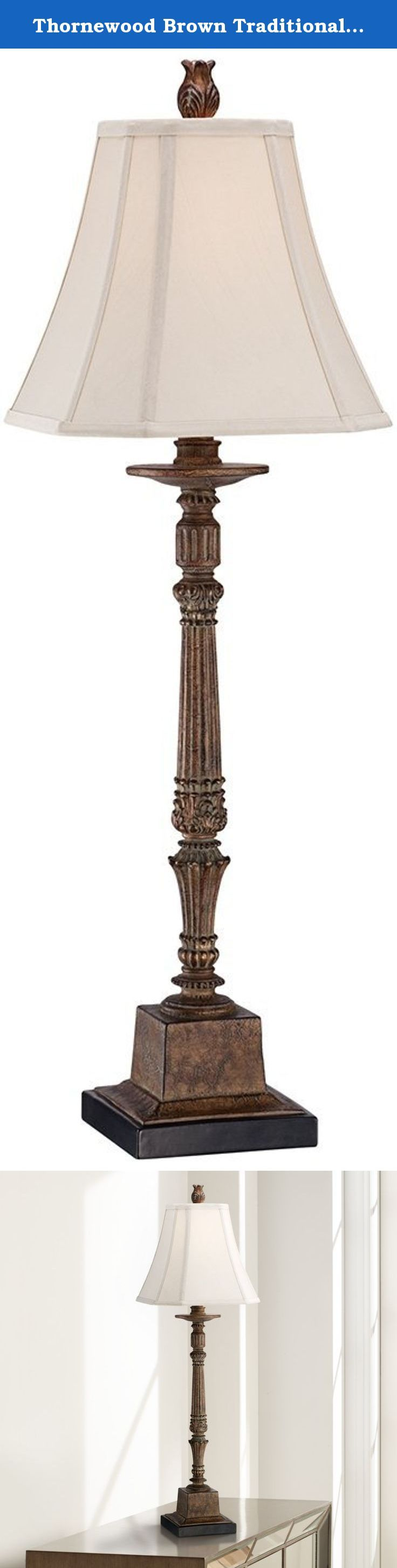 Thornewood Brown Traditional Console Table Lamp. This intricate console table lamp makes a great addition to any traditional living space. The slender candlestick base, which is propped up by a hearty square pedestal, features ornate scalloped and scroll detailing in a lovely crackled brown finish for an aged look. A square bell shade adds playful curves to the design, and a stately, textured finial tops the look. From the Regency Hill collection of table lamps. - Resin construction. -...