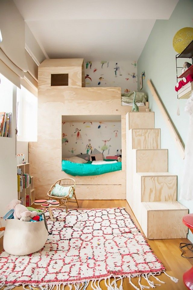 Small kids' room with a clever built-in bunk-bed palace that allows for maximum square footage