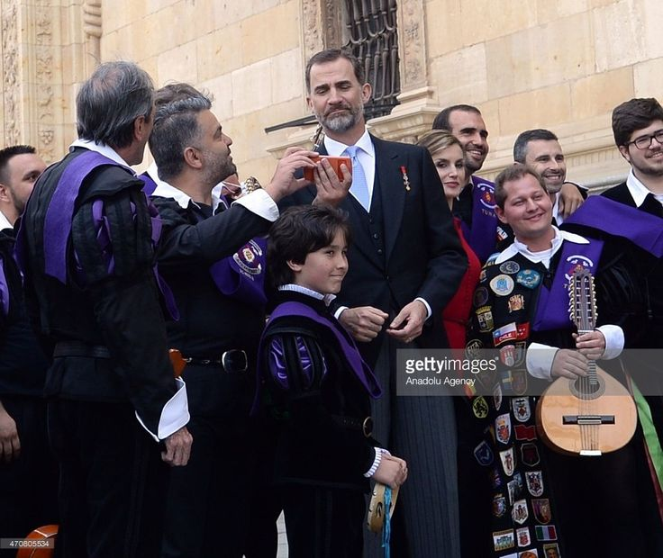 A Spanish musician talks to Spain's King Felipe VI and Queen Letizia as they leave the University of Alcala de Henares after the Cervantes Prize award ceremony in Madrid, Spain, on April 23, 2015. Spanish author Juan Goytisolo was presented with the Cervantes prize from Spain's King Felipe VI on Thursday April 23, 2015. The Cervantes Prize is awarded annually to honour the lifetime achievement of an outstanding writer in the Spanish language.