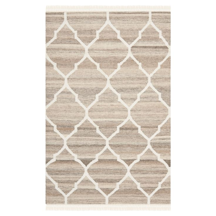 • 100% wool construction<br>• No backing<br>• Modern pattern<br>• Fringed edges<br>• Flat weave<br>• Machine woven<br>• Vacuum regularly; use rug pad<br><br>Add a modern appeal to your space with the Safavieh Sofitel Nautral Kilim Dhurry Rug. With neutral tones and durable construction, this rug will bring lasting style to your décor. Comfortable to walk on and able to withs...
