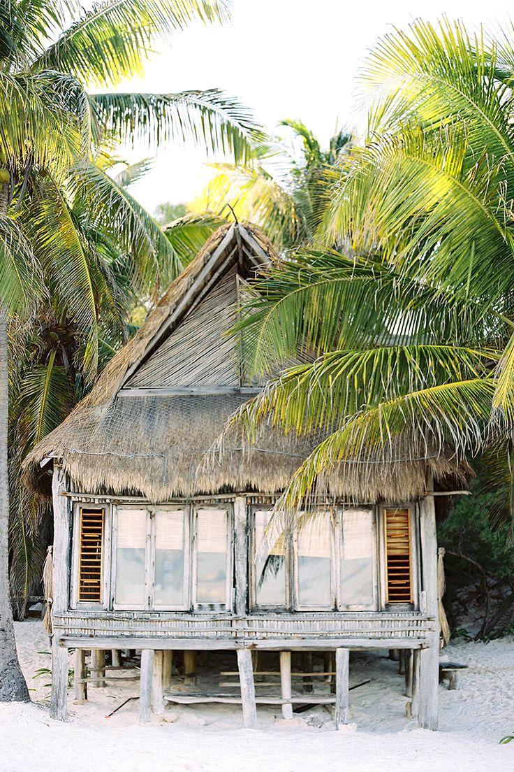 Tulum, Mexico hut among palm trees