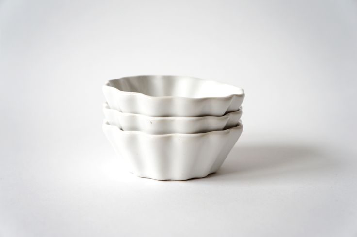 brika white scallop dish by the object enthusiast.