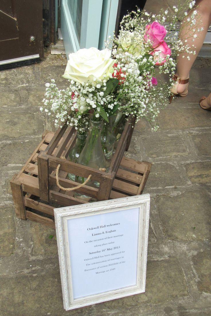 DIY wedding flowers. Wine bottle vases. Wooden crates.