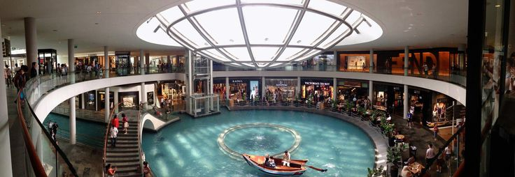 The water gondola ride going through the middle of the Shoppes at Marina Bay Sands.