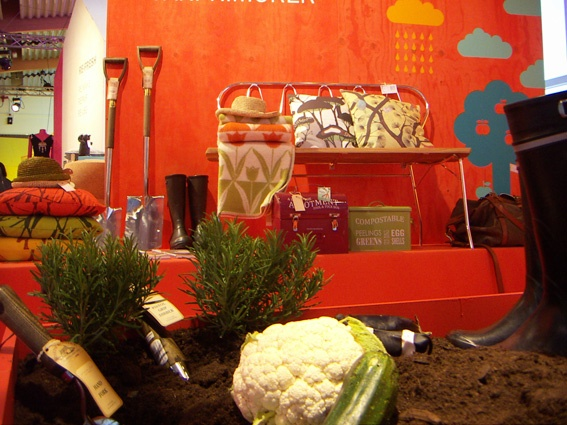 Trend zone at Formex. Behind plants, cauliflower and soil, beside the garden tools and boots, garden hats from La Maison Afrique FAIR TRADE.