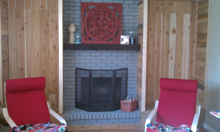 Revised fireplace with Scandinavian wood bins made from recycled pallet wood (more leftovers) and cedar fencing.