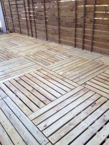 Example of platform or floor built with pallets (Dunway Enterprises) For more info (add http:// to the following link) www.dunway.info/pallets/index.html