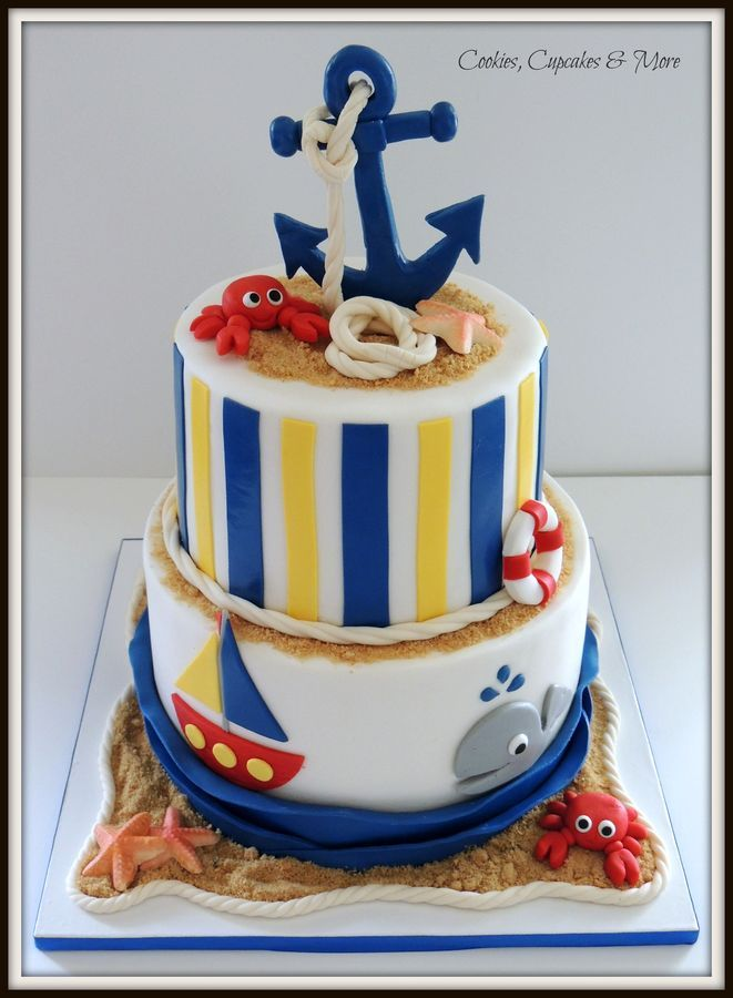 Vanilla and chocolate cake with swiss meringue buttercream. Star fish made from white chocolate, crabs and anchor made from gumpaste. All o...