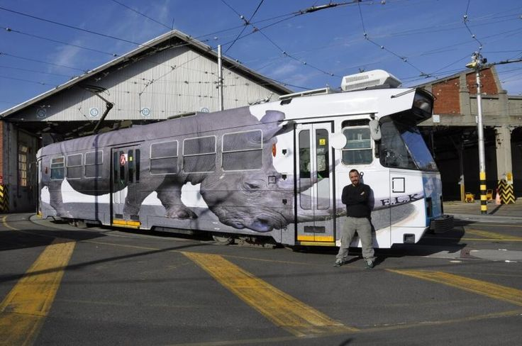 Luke Cornish next to one of his stencil works on a Melbourne tram - awesome piece