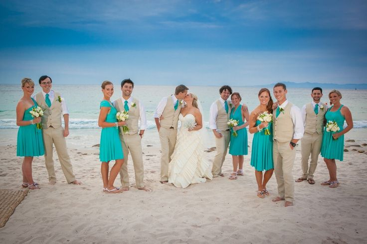 Cool pic, highlights the maid of honor and best man while still focusing on the bride and groom
