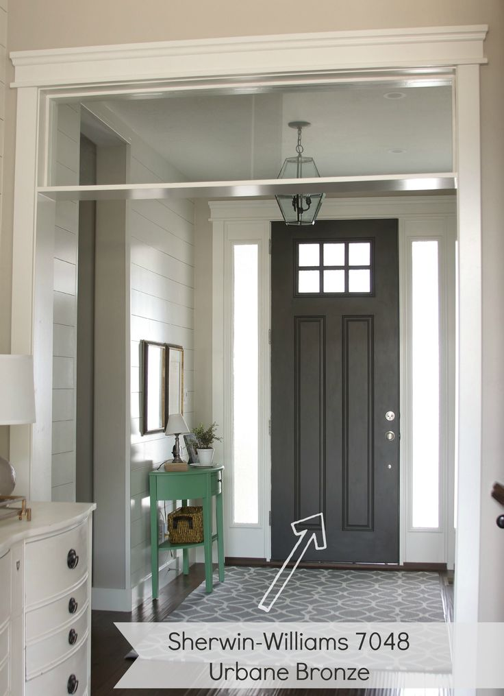 entryway with dark gray door. urbane bronze by Sherwin williams ...