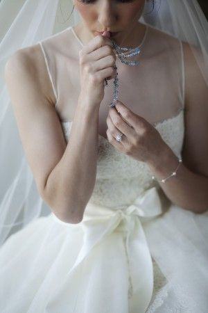 Sleeveless wedding gown with sheer overlay and bow waist detail | photography by http://www.cadencecornelius.com/