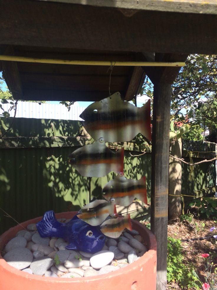 Hanging tin fish that peter made