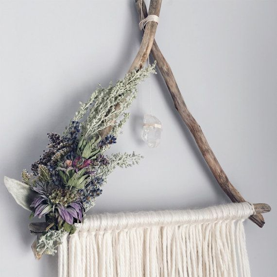 The softest ivory yarn, real driftwood and beautiful dried herbs. A hanging quartz completes this botanical, bohemian piece *driftwood will vary slightly but all pieces are beautifully weathered* To purchase both shown as a set at a special price please refer to this listing: https://www.etsy.com/ca/listing/287450269/juniper-hazel-set-of-2-triangle Meadow & Moss designs are all handcrafted with love. Each wall hanging is adorned with only all natural, real materials. Driftwood pieces are ...