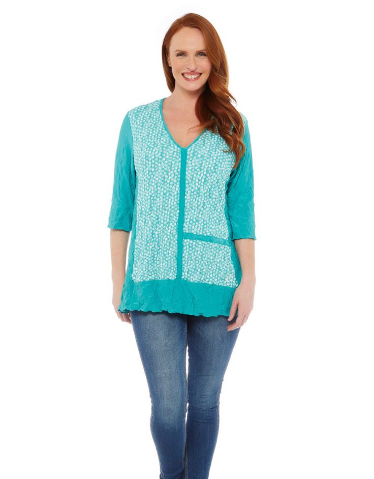 Kathleen Berney, Fashion designer. Spot Panel Tunic Kathleen Berney V-neck tunic with contrast spot mesh panel overlay and elbow length sleeves. The hip length tunic looks great with a narrow pant. Made from Kathleen Berney's crushed breathable polyester which is comfortable to wear, easy to wash and absolutely no ironing required. An ideal travelling companion#fashion #designer