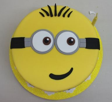 What a cute cake at a Minion birthday party! See more party ideas at CatchMyParty.com!