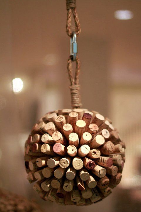 22 ways to repurpose wine corks including these hanging cork balls as seen in Anthroplogie: