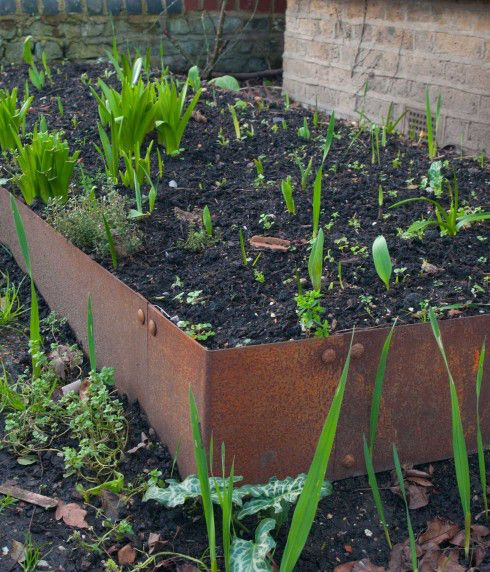 Check out this custom Cor-Ten steel raised bed. Steel offers the  perfect permanent alternative to a wooden raised garden bed #steel #vegetablebed #gardenbed
