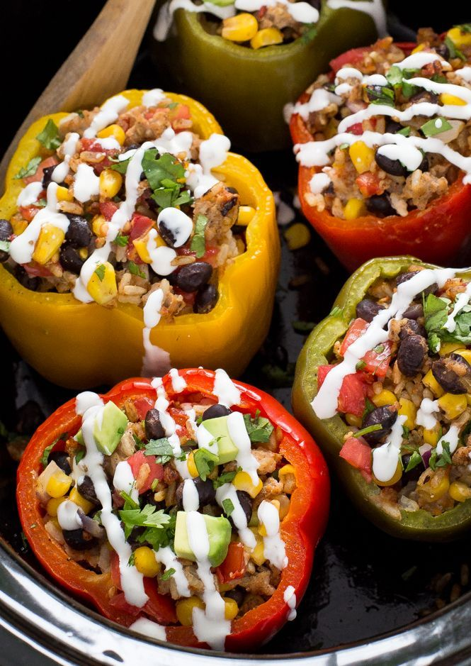 Mexican Slow Cooker Stuffed Peppers. Loaded with enchilada sauce, black beans and corn. A quick, easy and satisfying meal! Recipe from chefsavvy.com
