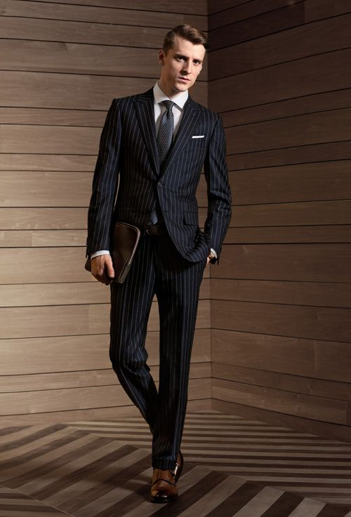 Ermenegildo Zegna Su Misura Collection    14 MILMIL 14  This blue/light grey pinstripe suit is a revisited classic in the finest 14 MILMIL 14 wool. For a strong masculine appeal, wear the suit with a contrasting white pocket square and some elegant monk-strap shoes.