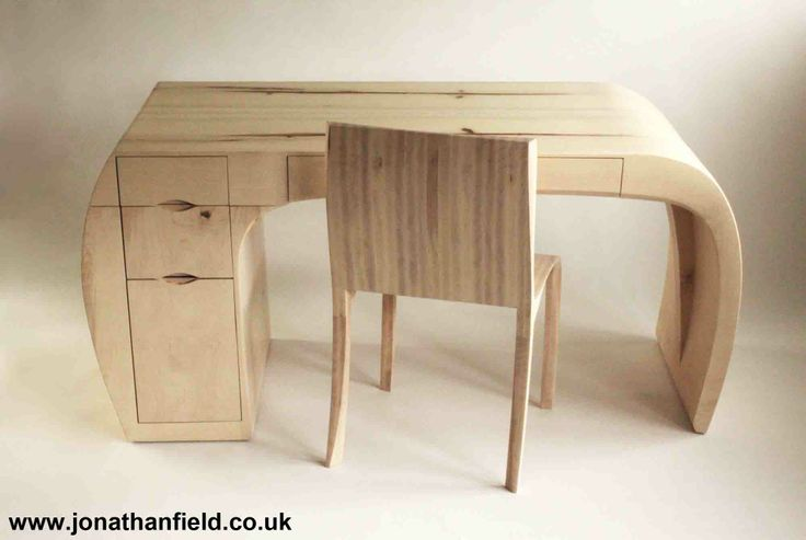 Solid ripple sycamore desk and chair, steam bent with a white oil finish and four drawers. The top and sides of the desk are made from two pieces of solid mirrored ripple sycamore, joined along the waney edge and steam bent to give the curved shape to the leg and outer drawer side. The front legs of the chair reflect this shape with the high curve to the inside of the seat side. One of an edition of three. Designed to go with the Ripple sycamore chair www.jonathanfield.co.uk