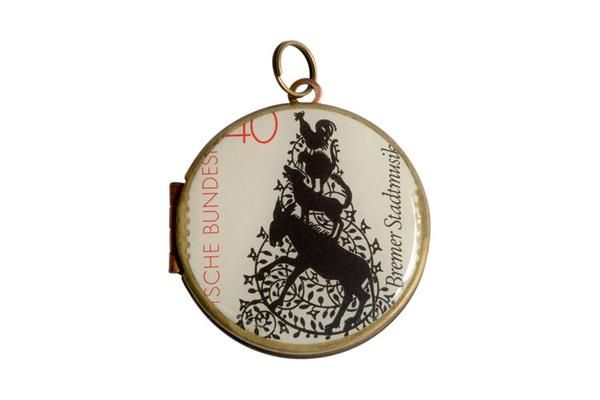 This original German postage stamp was released in 1982 featuring  The Town Band of Bremen (German fairytale). The vintage locket is made from brass and copper and measures 30mm in diameter. The locket opens from the side and is capable of holding 2 of your most precious memories inside.