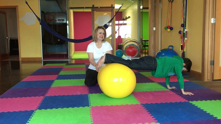 Movement Therapy using a Peanut Ball for improving the Prone and Supine Positions - If your child struggles with attention, focus and behavior issues in the classroom, it could be due to low muscle tone or poor balance and coordination. Use ...