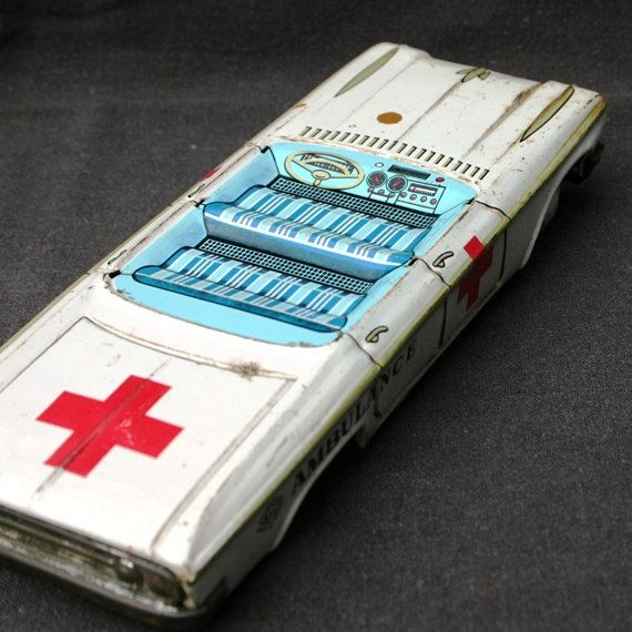 Did you call 911. Antique tin toy ambulance.