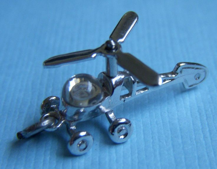 Vintage movable helicopter rotor spins sterling charm