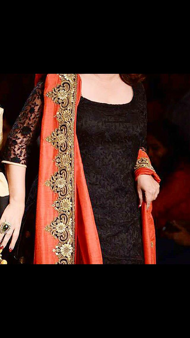 Black net and orange dupatta Punjabi suit