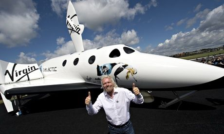 Richard Branson in front of a model of the Virgin Galactic rocket which is designed to deliver small satellites into orbit.  Photograph: Adr...
