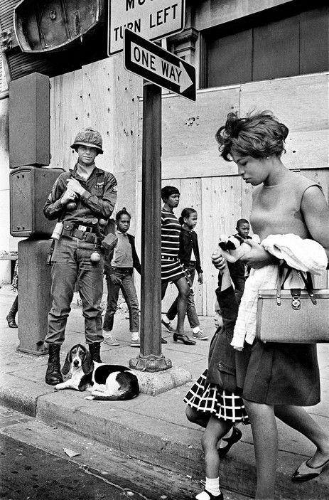 © Rene Burri/Magnum Photos // Washington D.C. US army guarding intersection after riots. 1968.