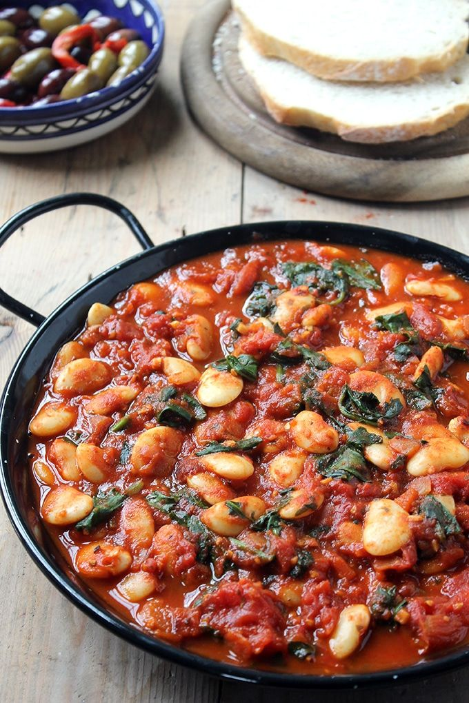 These Spanish Beans with Tomatoes are easy to make, and the smoky sweet spices make it perfect to serve as tapas or a side dish, with crusty bread. Vegan.