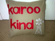 handmade cushion with 'karoo kind' wording and windmill design to brighten up any space, from www.ietsienice.co.za