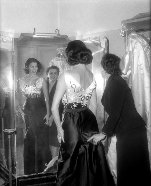 Ava Gardner being fitted into one of the magnificent designs of the Sorelle Fontana. Rome, 1955