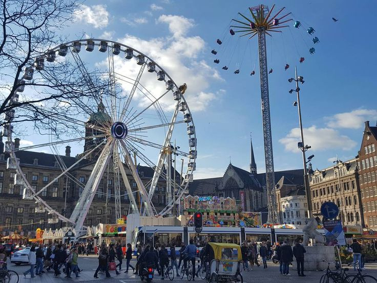 The Dam Square in Amsterdam  #amsterdam #netherlands #amsterdamworld #travel #afternoon #ferriswheel #dam #square #damsquare #bluesky #clouds #street #streetphotography #galaxys6