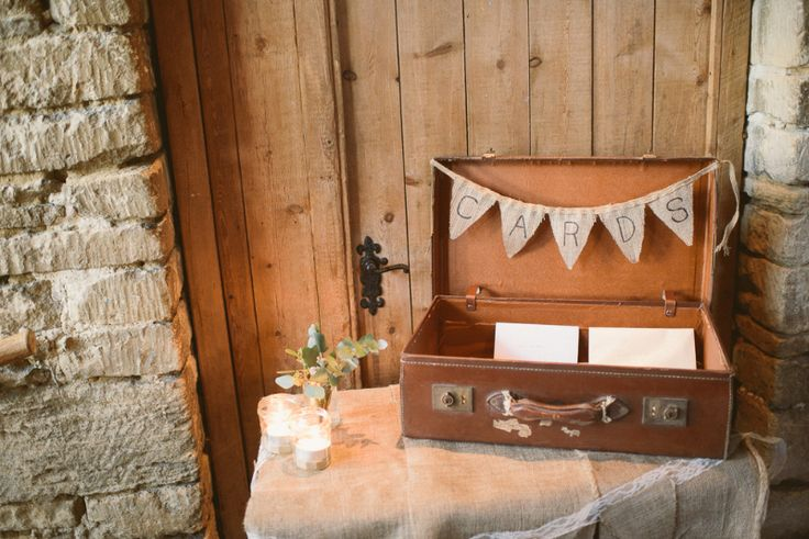 Image by Ellie Gillard - A rustic winter wedding at Cripps Barn with DIY home made decor and Halfpenny London bridal gown, blue maids dresses and photography by Ellie Gilliard