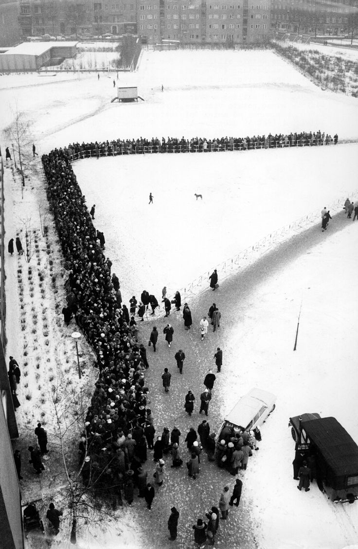 December 1963: Residents of West Berlin queueing and waiting to receive their pass in order to spend Christmas with their relatives living in East Berlin. Photo: Angelo...