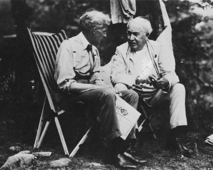 henry ford with thomas edison. thomas edison relaxes with henry ford during one of their famous camping trips around