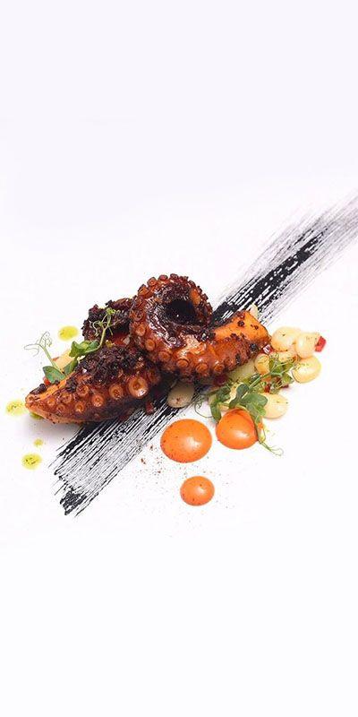 Charred Nduja octopus, black garlic, romesco, lima beans, piquillo pepper, and salsa verde