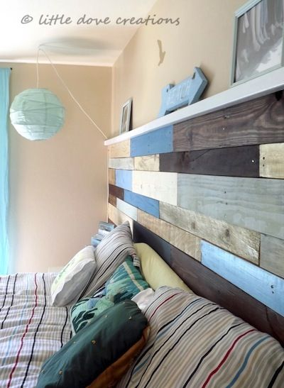 Pallet Wall Add interest to a pallet wall by using various colors of paint and stain before hanging.: