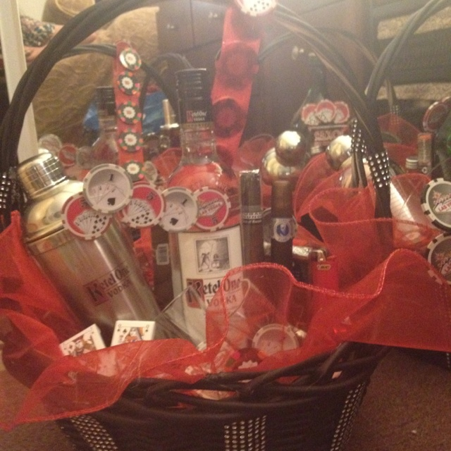 Husbands 30th was a casino themed surprise party . So I made alcohol baskets with cigars , poker chips etc (each table was a different type of alcohol)