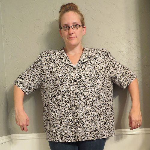 This $2 XL button-down blouse had shoulder pads out the wazoo and absolutely no shape (though I suppose square is a shape). But I really liked the floral print and the flowy-ness of the fabric.I removed the shoulder pads and the dated buttons, and sewed the button band closed. I turned the whole thi
