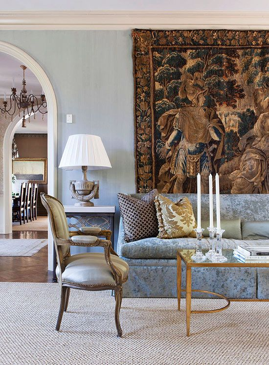 The icy blue palette of the living room lets the beautiful antique Flemish tapestry pop in this Mediterranean home - Traditional Home®  Photo: Reid Rolls Design: Roger Higgins and Ann Shipp